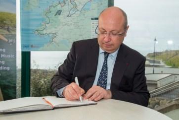The ambassador signs the Bundoran visitor book. Pic CMP Productions — with Ambassade de France en Irlande at Discover Bundoran.