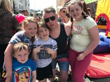 Shane McGrath with the McGraths and McNamaras enjoying the street party
