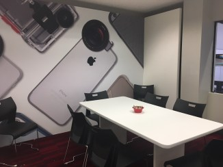 CES 2017 conference room design featuring smartphone collage