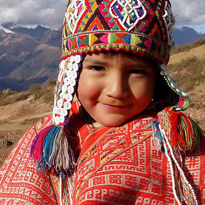 peruvian child encountered on a volunteer vacation in peru