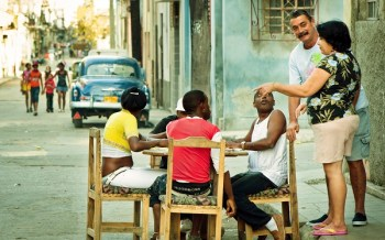 cuba-sitting-at-table-in-street 600 x 375