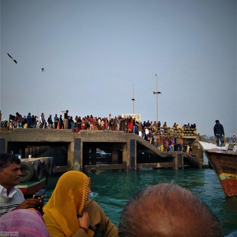 Passengers waiting for a boat at okha jetty