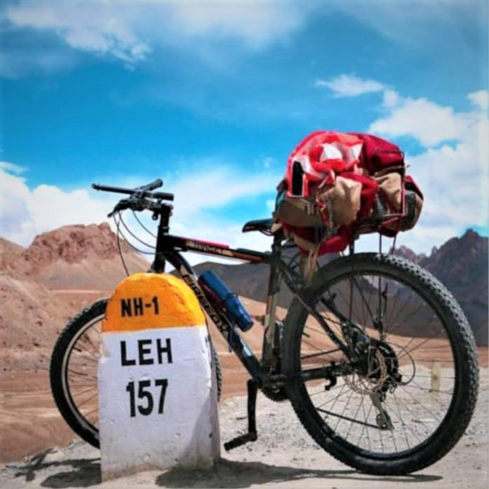 Cycle standing near milestone of LEH