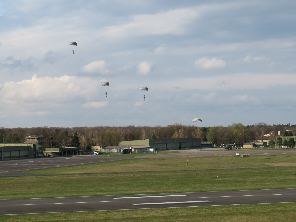 Multiple paratroopers approaching the LDZ (landing zone)