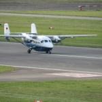 Parajumper drop plane D-CPDC (M28) approaching runway 08 at Celle-Wietzenbruch for landing.