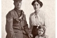 Photo of a soldier with his family