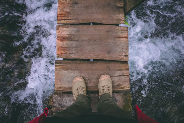 Standing on wooden bridge