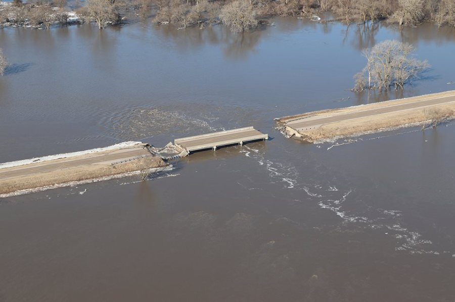 How to help after a natural disaster. Flood photo with road out.