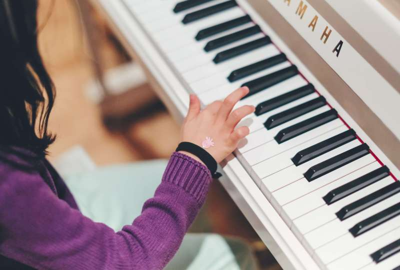 piano lessons for kids girl at piano