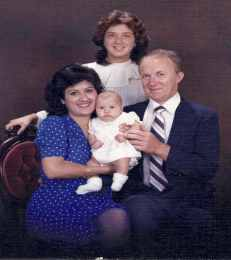 Me with my mother, father, and baby sister.