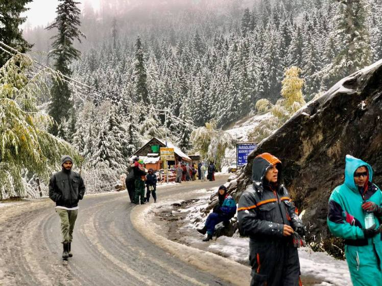 Tourist enjoy snowfall at Kothi