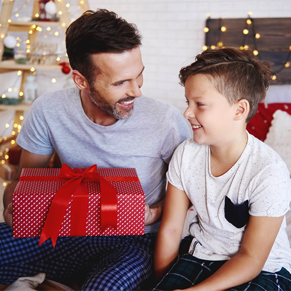 Smiling father grateful for Christmas present his son has given him