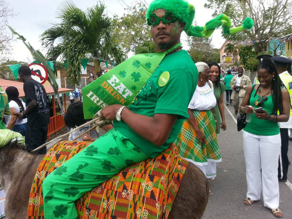 Radio Personality Basil Chambers arrives to the Slave Feast in style. (Discover Montserrat Photo)