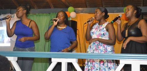 Some of the ladies from the adult section of the national choir perform at the farewell party for music teacher Cris van Beuren. (DiscoverMNI Photo)