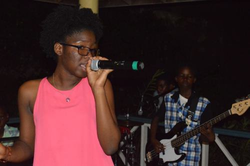 Nia Golden sings lead with Pulse at the Cris van Beuren farewell party organised by the Youth Department. (DiscoverMNI Photo)