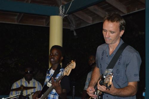 Cris van Beuren plays lead guitar with Pulse. Delroy Joseph Jr on drums and Joshua Golden on bass. (DiscoverMNI Photo)