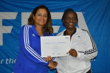 Salem Nursery teacher Arietta Buffonge receives her certificate for completing the FIFA Grassroots Coaching Course from Facilitator Andrea Rodebaugh-Huitron.