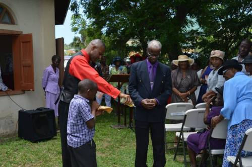 Pastor Toney Allen anoints the earth.
