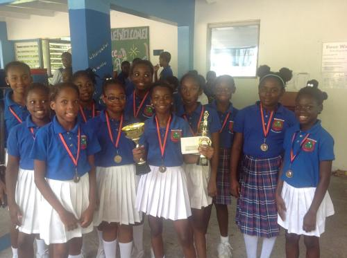 St Augustine girls' netball team show off their trophy and medals. (Wannis Persaud Photo)
