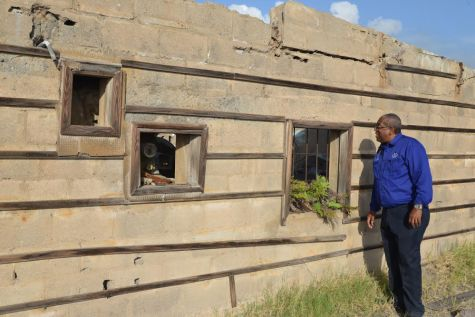 Professor Dale Webber visits the ruins of the abandoned cinema in Plymouth, Montserrat. Photo: Roderick Stewart/MVO.