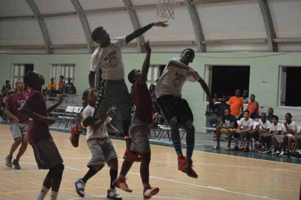 Elite boys get airborne during their match up against the MS Hornets. (Nerissa Golden Photo)