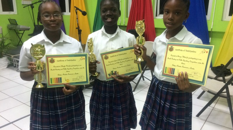Khayla West, Jaena Golden and Sharyn White of Grade 6 pose with their trophies and certificates.