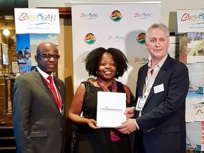 CTO 2018 Caribbean Travel Media Awards: Ursula Petula Barzey receiving Best of the Best Award. Presenting: Hugh Riley, Secretary General, Caribbean Tourism Organization and Trevor Sadler, CEO, InterCaribbean Airways.
