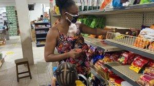 Sharlene Lindsay shopping at Victor's Supermarket