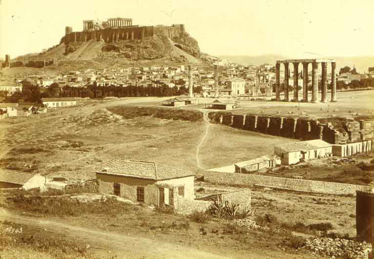 A post-classicism perspective: In this photograph of Athens taken between 1868 and 1875 by French photographer Félix Bonfils, the absence of people was intentional. Bonfils created commercial photographs meant to appeal to Western tourists, so his images reflect a noble and refined city, consistent with the vision of Greece as the foundation of Western civilization. The photograph shows the Arch of Hadrian with the Acropolis in the background. (Image courtesy of Princeton University Library Rare Books and Special Collections)
