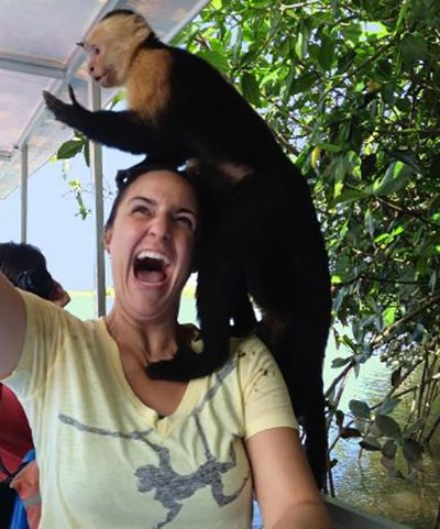 Monkey jumped on a woman's shoulder