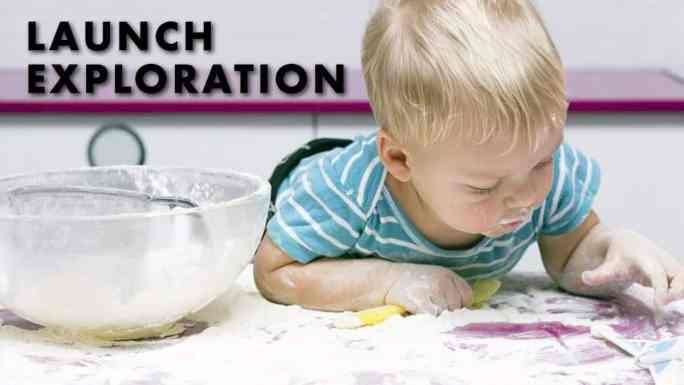 exploratory play-launch exploration-little boy playing in spilled flour in the kitchen