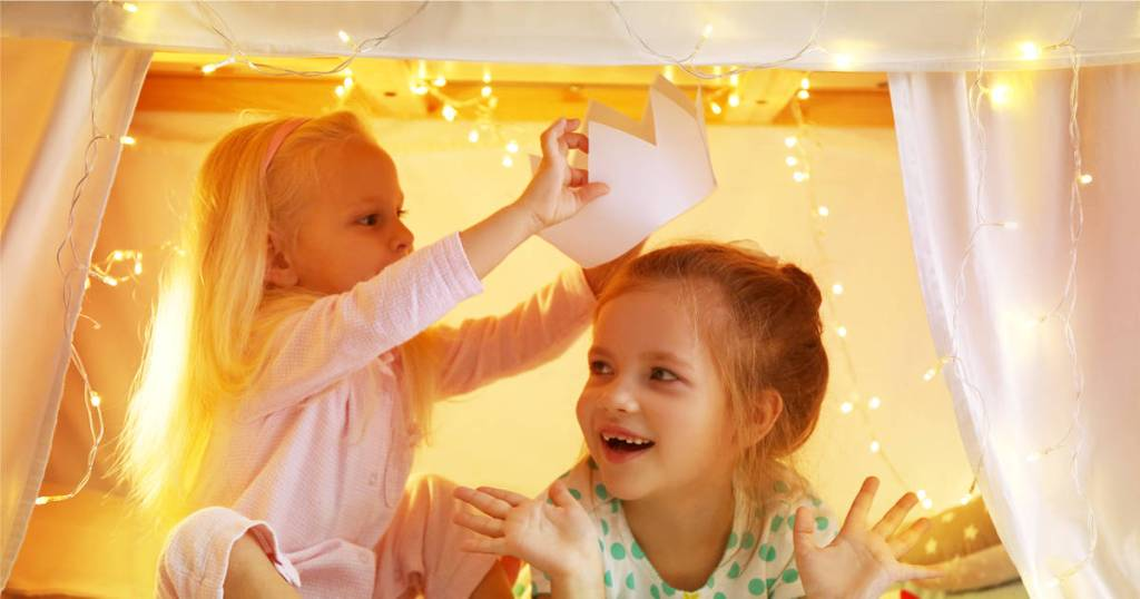 Imagination and creativity- Walt Disney Quote with girls playing under a make-believe tent with a paper crown