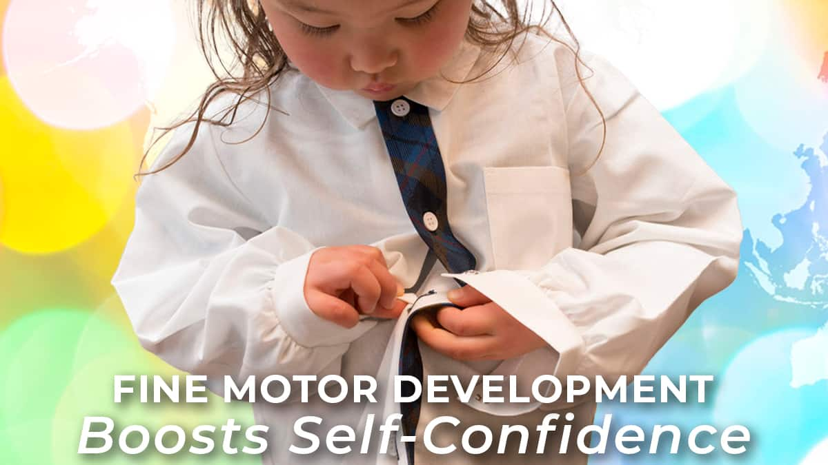 fine motor development- self-confidence-independence-toddler girl working to button her shirt