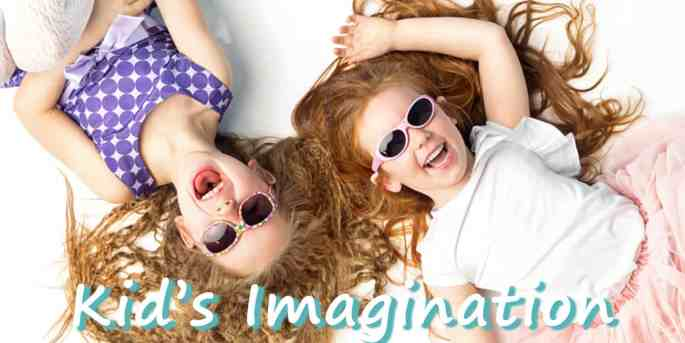 kids imagination-twin girls lying face-up on the floor laughing