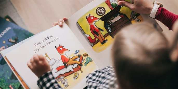 emotional and social development activities for toddlers-reading a book