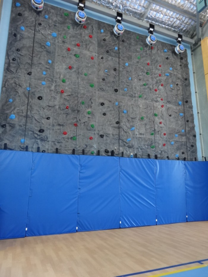 An Indoor Rock Climbing Wall at a School
