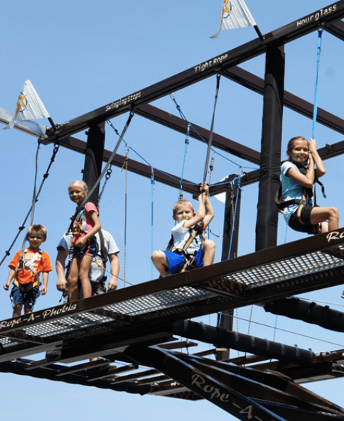 Ropes Course that connect to rock climbing walls