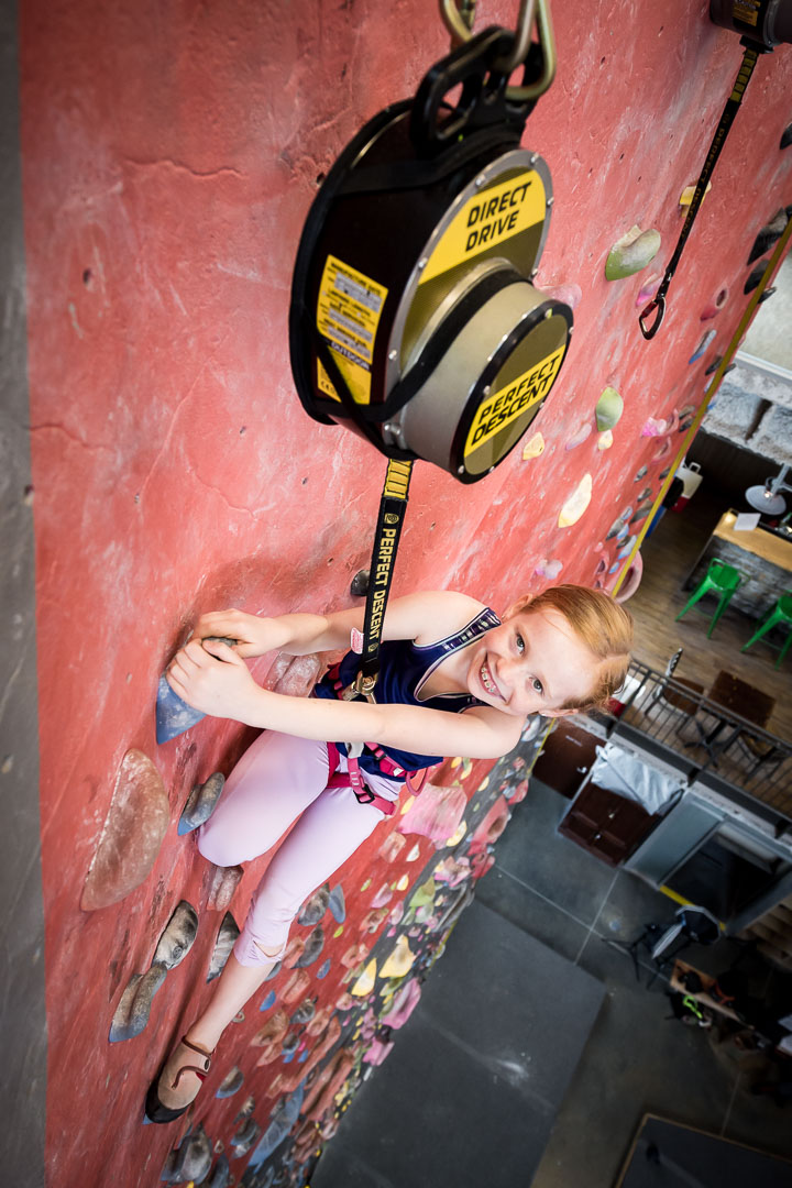 girl climbing on a perfect descent automatic belay