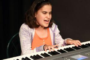 Caitlin at piano - blind actress
