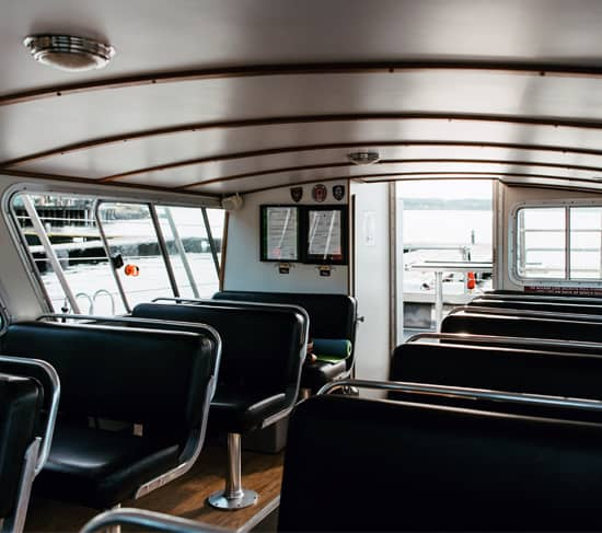 Discovery Marine Safaris Adventure Tour boat Tenacious III's spacious cabin from the Captains chair