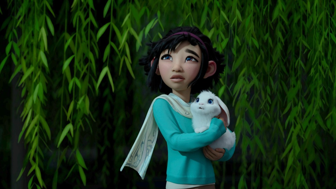 Fei Fei looks up to the sky while holding her pet rabbit in 'Over the Moon.'