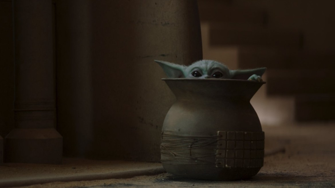 Baby Yoda hides in a sack in Chapter 9 of The Mandalorian