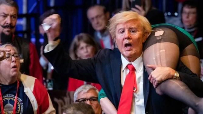 Borat wears a fat Donald Trump suit at a Republican event in Borat 2