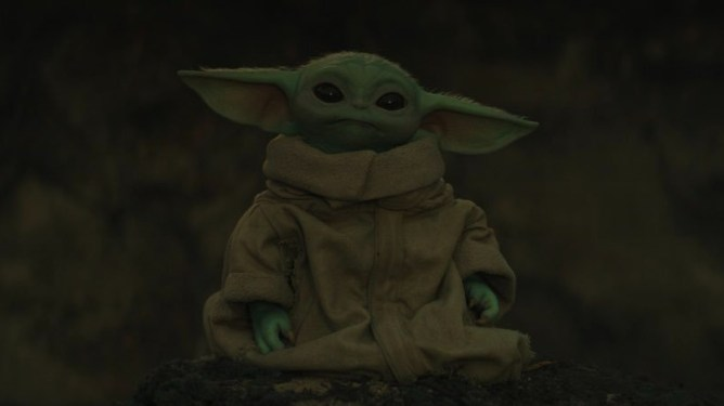 Baby Yoda now known as Grogu sits patiently as seen in Chapter 13 of The Mandalorian.