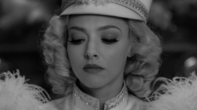 Amanda Seyfried looking stunning as Marion Davis in a white dancing costume as seen in Mank.