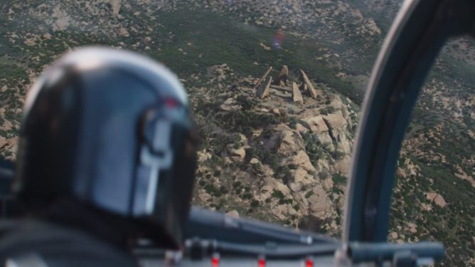 Pedro Pascal's Mando prepares to land on an ancient Jedi temple as seen in Chapter 14 of The Mandalorian.