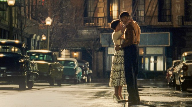 Tessa Thompson and Nnamdi Asomugha hold each other dearly in the middle of an empty Harlem street as seen in Sylvie's Love.