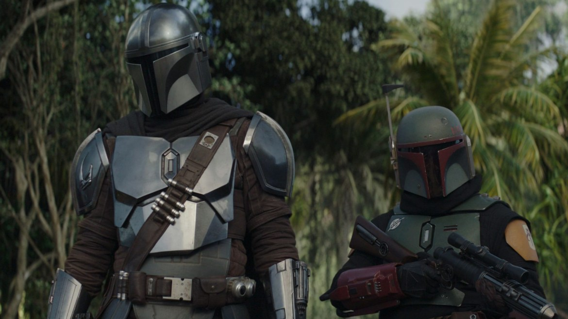 Pedro Pascal's Mando next to a Boba Fett with clean new armor as seen in Chapter 15 of 'The Mandalorian'.