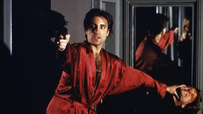 Andy Garcia taking on a hit men in a red satin robe as seen in Francis Ford Copppola's 'The Godfather Coda.'