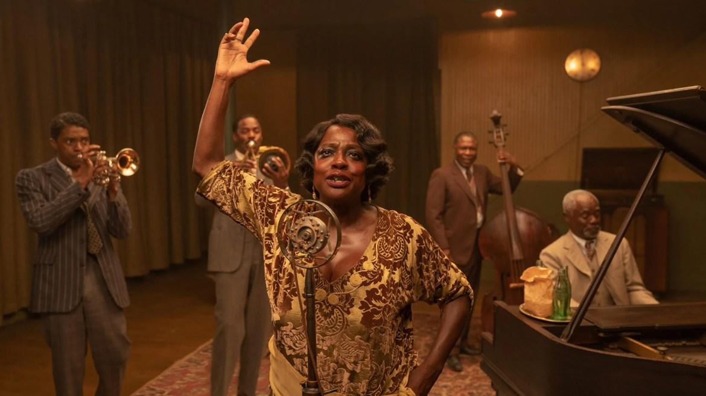 Chadwick Boseman and Viola Davis lead a passionate Jazz ensemble in a recording studio as seen in Ma Rainey's Black Bottom.
